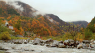 Stock Video Footage of Autumn. Mountain hotel on the banks of the river.