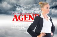 Stock Illustration of Composite image of businesswoman standing with hands on hips
