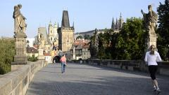 Prague, jogging on charles bridge Stock Footage