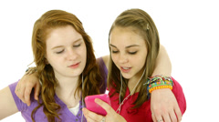 Two teenage girls listening to music isolated over white Stock Footage