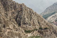 rock tombs in amasya, turkey - stock photo