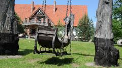 Quiet park swings big old wooden sled dekorativines swing Stock Footage