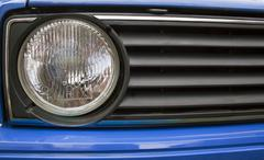 Close up old of automobile grille and headlight Stock Photos