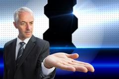 Composite image of concentrated businessman with palm up Stock Illustration