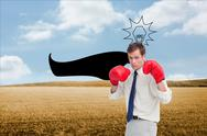 Stock Illustration of Composite image of businessman with his boxing gloves ready to fight