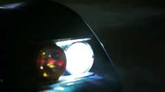Shallow focus on Corvette's lights at nigh time Stock Footage
