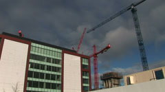 Cranes used in the city to build - stock footage