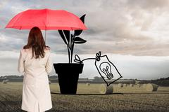 Composite image of businesswoman standing back to camera holding red umbrella - stock illustration