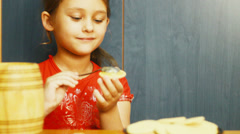 Girl puts honey on the spoon cookies Stock Footage