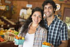 An Organic farm. A man and woman working together. Stock Photos