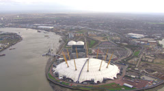 Aerial view above London's O2 arena beside the River Thames Stock Footage