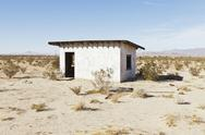 Stock Photo of A small abandoned building in the Mojave desert landscape.