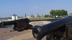 Cannons at harbour mouth + pan canal and fortified town of Hellevoetsluis Stock Footage