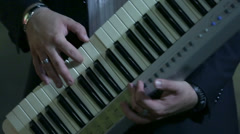 Man holding the synth and playing it Stock Footage