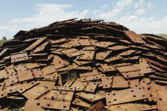 Pile of rusty plates, used for railroad construction. Recycling or rubbish Stock Photos
