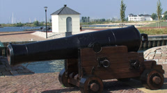 Cannons at harbour mouth, marina in background + pan canal and fortified town Stock Footage