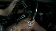 Stock Video Footage of Woman hands holding and turning the sterring wheel of blue Corvette