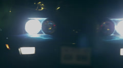 Shallow focus pan shot of Crovette's headlights - stock footage