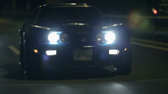 Frontal shot of Corvette with headlights turned on Stock Footage