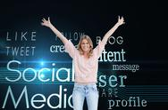 Stock Illustration of Composite image of full length shot of a smiling woman with her arms raised up