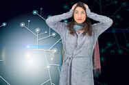 Stock Illustration of Composite image of anxious pretty brunette wearing winter clothes posing