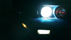 Pan shot of light up Corvettes headlights - stock footage