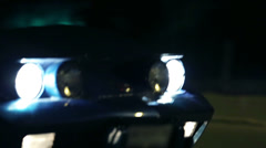 Shot of Corvette's headlights at night city drive Stock Footage