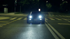 Frontal view shot of blue Corvette heading towards the camera Stock Footage