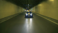 Stock Video Footage of Distant shot of blue Corvette driving at night in a tunnel
