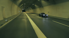 Blue Corvette driving fast through the tunnel Stock Footage