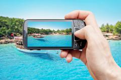 Smart phone at paradise island Stock Photos