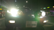 Stock Video Footage of Low angle Corvette C3 shot at night drive through city