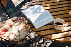 book and coffee on wood table - stock photo