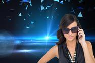 Stock Illustration of Composite image of serious elegant brunette wearing sunglasses on the phone