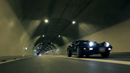 Stock Video Footage of Blue Corvette crosses the road in a tunnel
