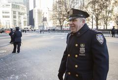 Friendly NYC police officer on W 59th street in Macy's 2013 parade - stock photo