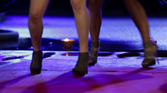 Women in miniskirts are dancing on red carpet Stock Footage