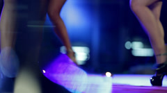 Long-legged women making dance steps on red carpet - stock footage