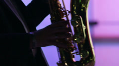 Male silhouette playing sax at night Stock Footage