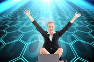 Stock Illustration of Composite image of businesswoman sitting in front of laptop with arms up