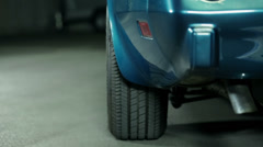 Pan shot of blue Corvette back side Stock Footage
