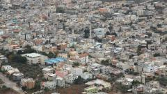 The Arab village Iksal near Nazareth pan Stock Footage