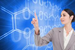 Stock Illustration of Composite image of young saleswoman operating touchscreen