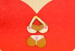 Bikini underwear shape gingerbread cake cookie red heart love symbol Stock Photos