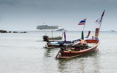 Long tail boats with a cruise on andaman sea Stock Photos