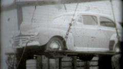 car craned onto a ship 1940s black and white vintage old film historic lefted - stock footage