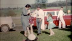 Family play sunday clothes with cars 1940s vintage fashion people lifestyle Stock Footage