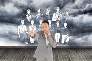 Stock Illustration of Composite image of thoughtful asian businesswoman pointing