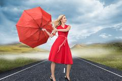 Stock Illustration of Composite image of beautiful woman posing with a broken umbrella