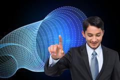 Stock Illustration of Composite image of smiling asian businessman pointing